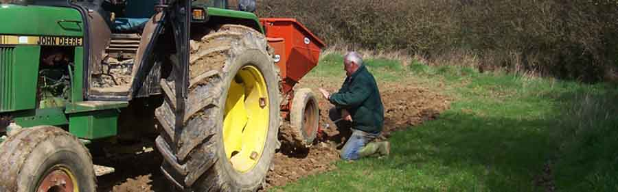 PETER TENDING THE TRACTOR